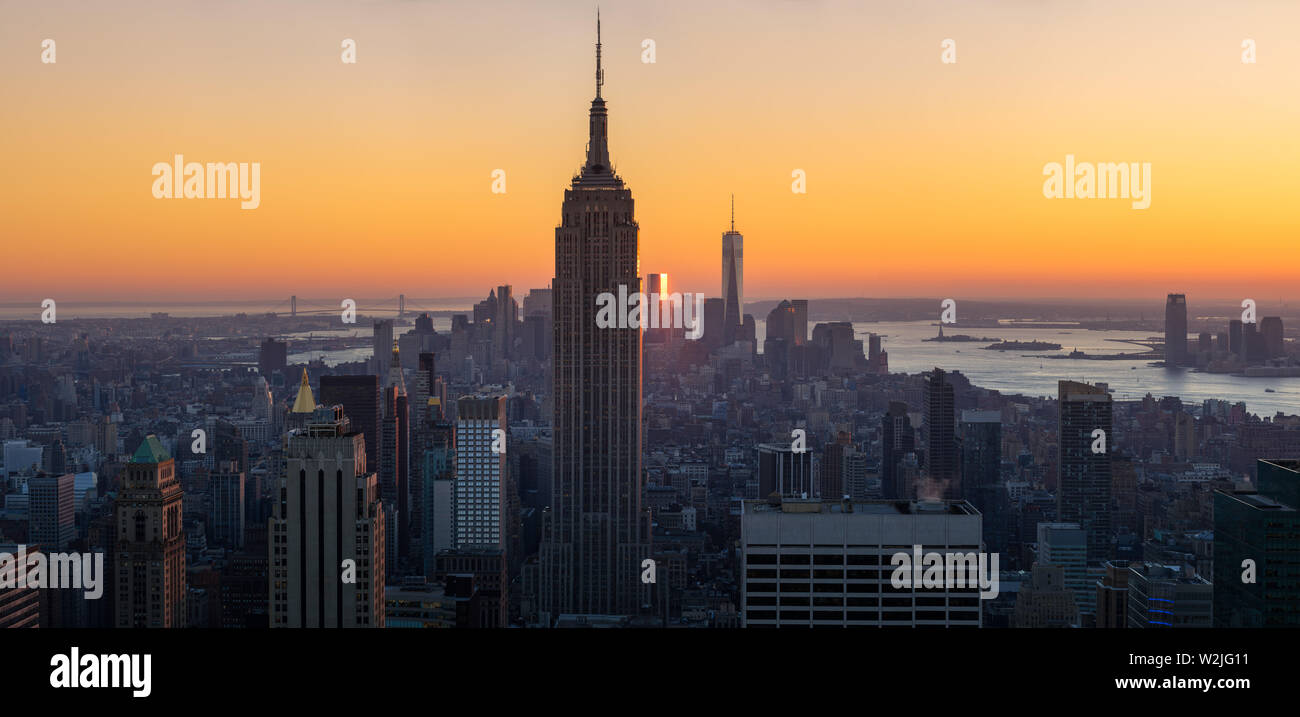 New York City, NY, USA - November 4, 2015:  Midtown Manhattan at Sunset and Skycsrapers (Empire State Building and World Trade Center) - Stock Image