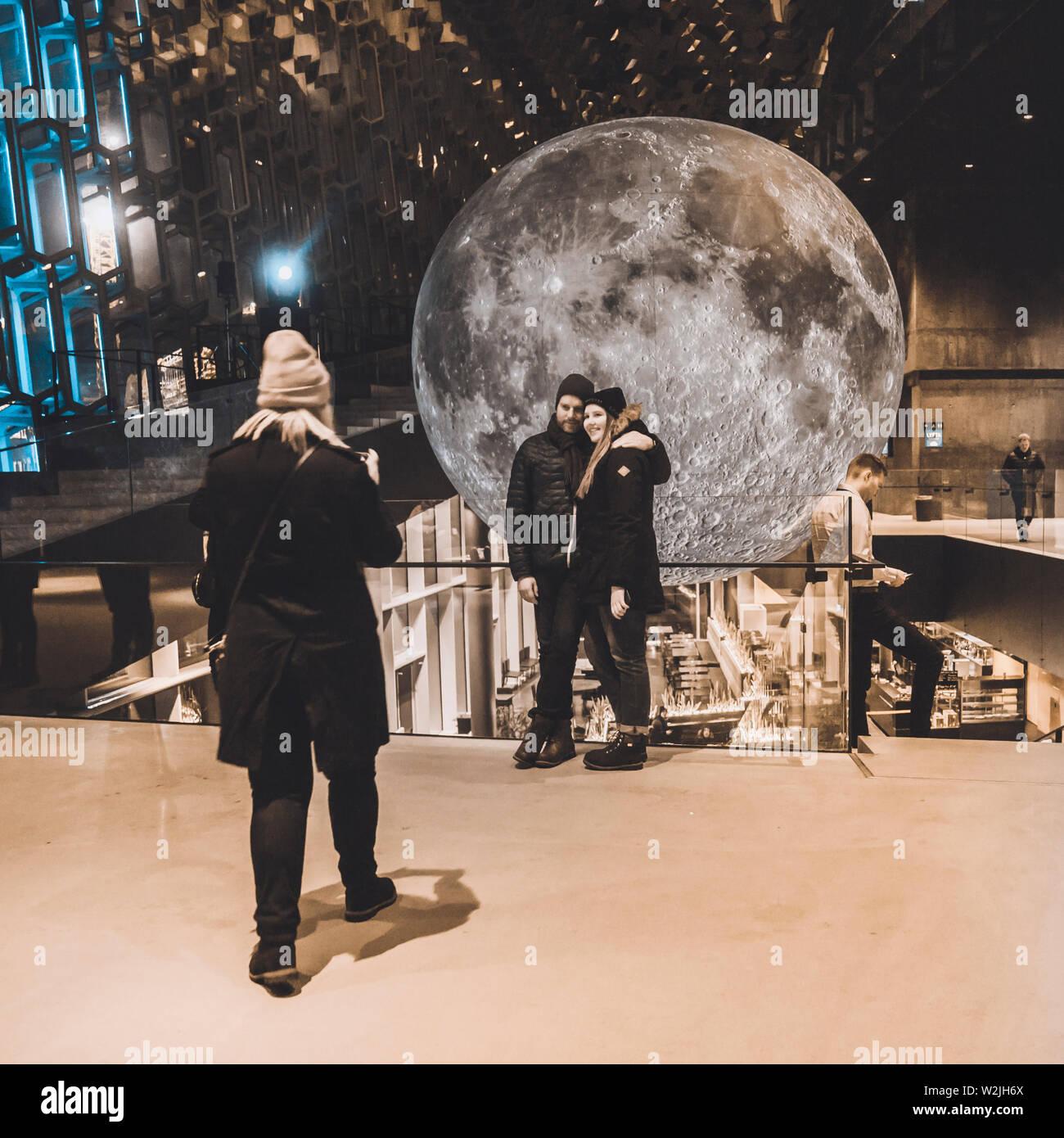 Museum of the Moon, art piece, by Installation artist Luke Jerram during The Winter Lights Festival, Harpa, Reykjavik, Iceland. - Stock Image