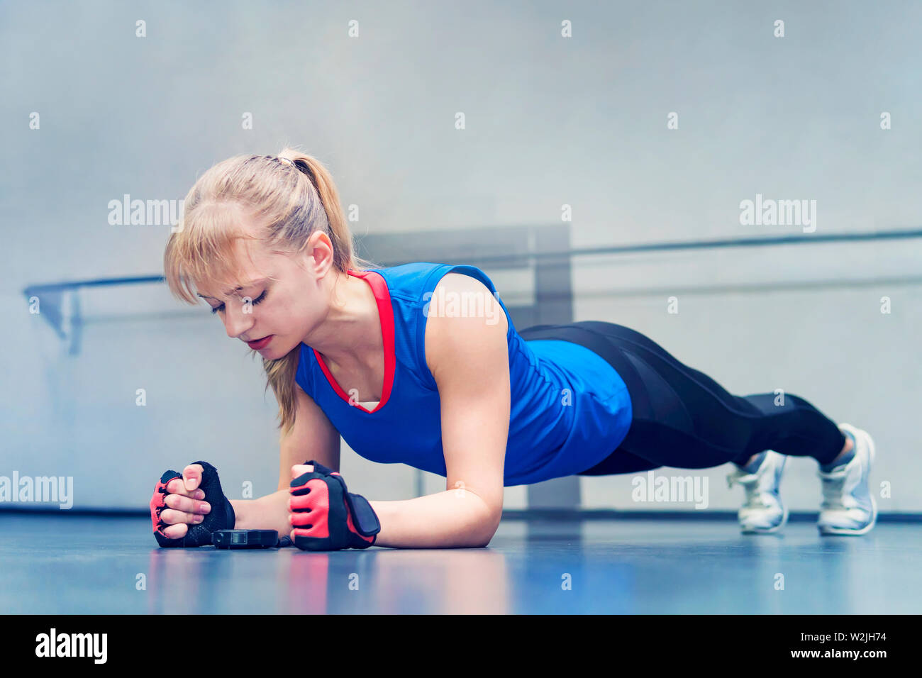 Woman doing push-up exercise  Strong female doing crossfit