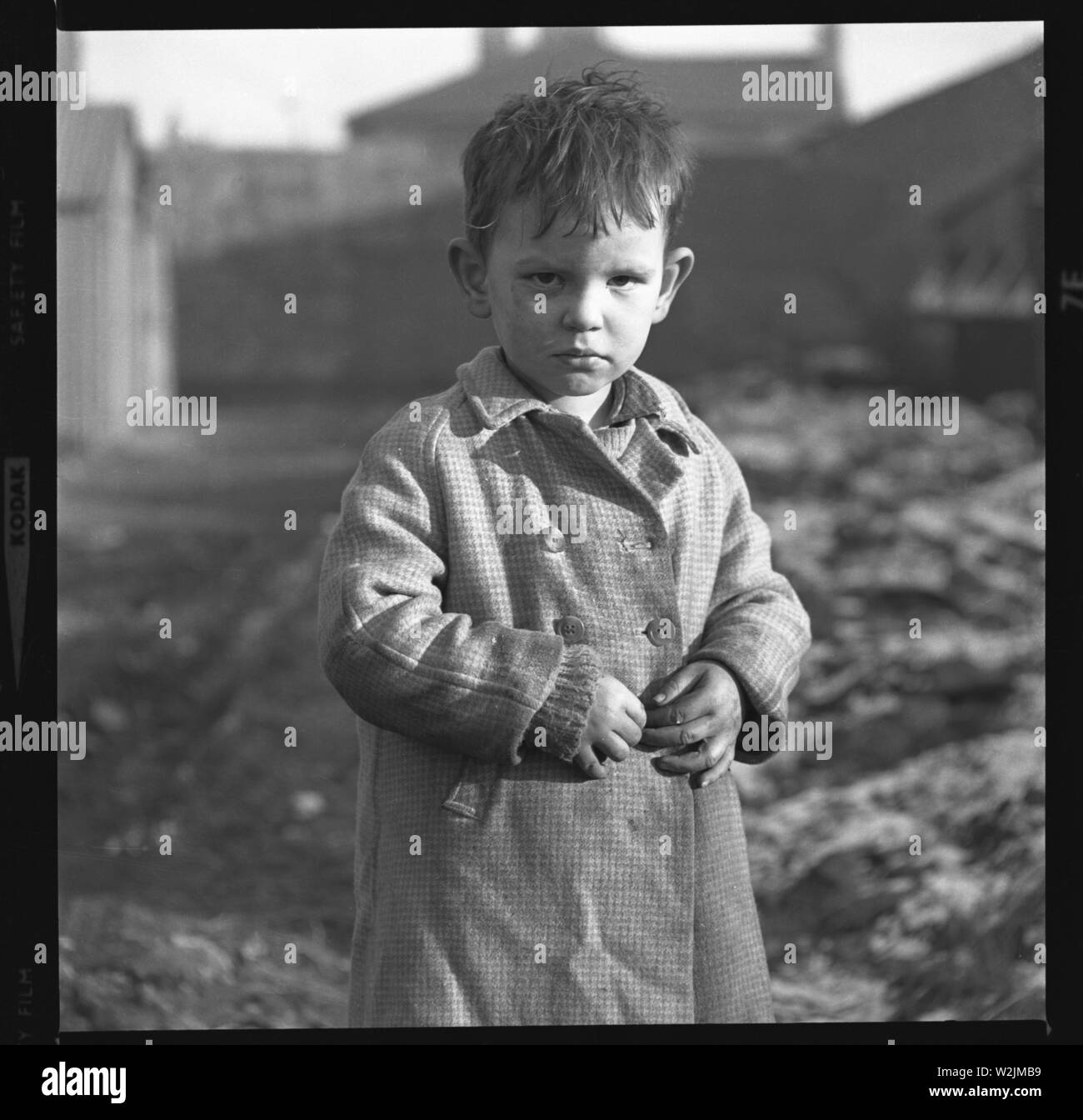 A telling portrait of a young boy, probably near the Sandyford area in Dublin, Ireland c1960 Photo by Tony Henshaw - Stock Image