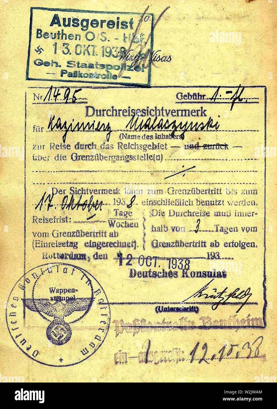1938 Gestapo border inspection stamp applied when leaving Germany. Transit visa for Germany in a Polish passport, issued in Rotterdam on 1938/10/12, valid for 3 days' transit. Overstruck by entry stamp from passport control station Bentheim on 1938/10/12, and exit stamp from Gestapo passport control service in Beuthen, Upper Silesia, central station on 1938/10/13. - Stock Image