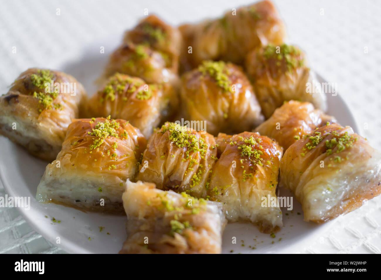 homemade turkish baklava dessert in plate with green pistachio Stock Photo
