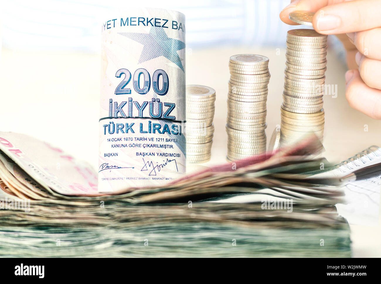 stacked turkish lira banknotes and coins Stock Photo