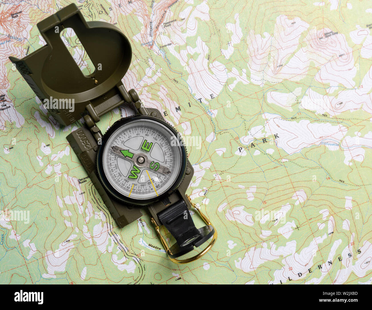 A compass on a map Stock Photo