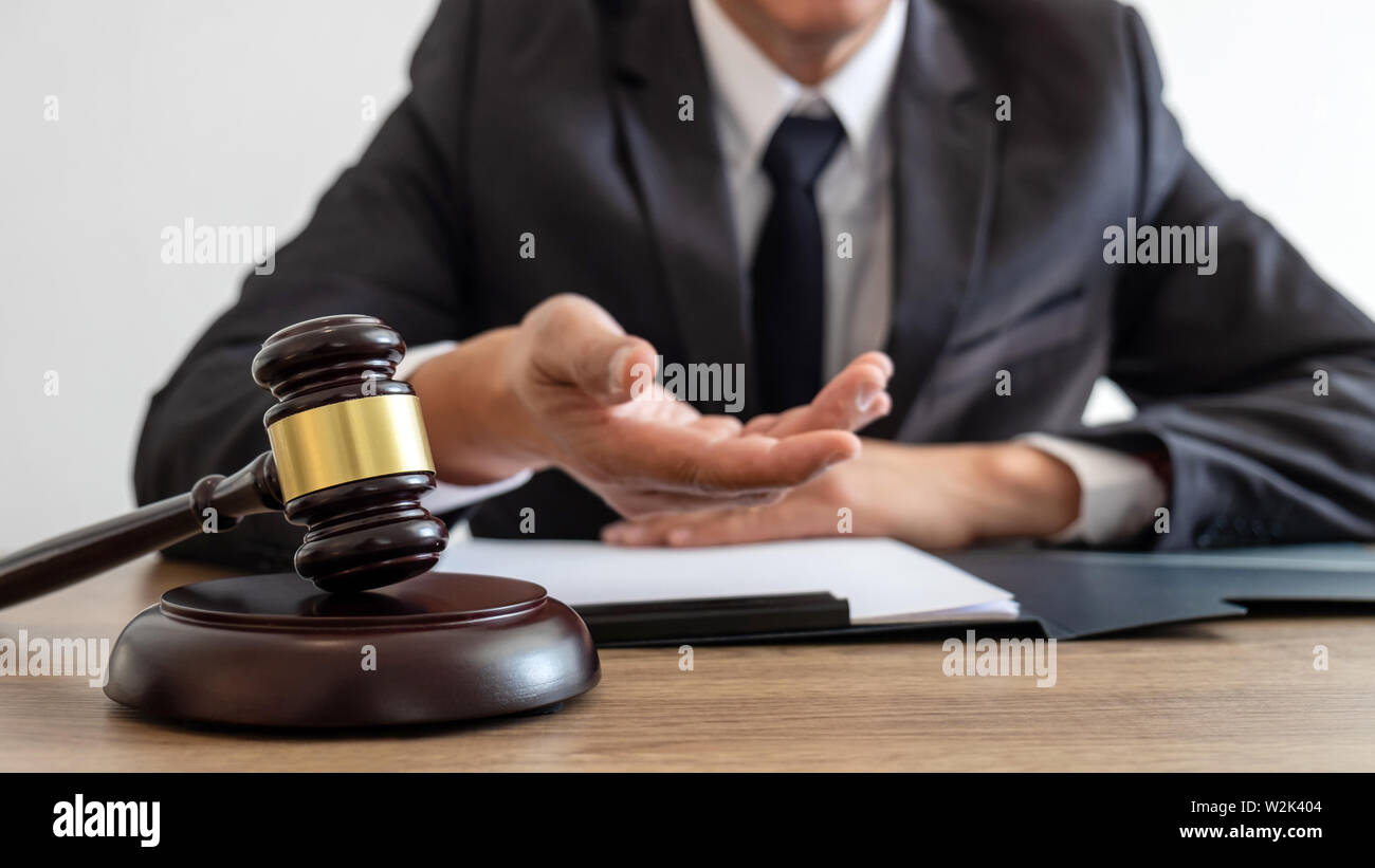 Law, lawyer attorney and justice concept, male lawyer or notary working on a documents and report of the important case in the law firm. Stock Photo