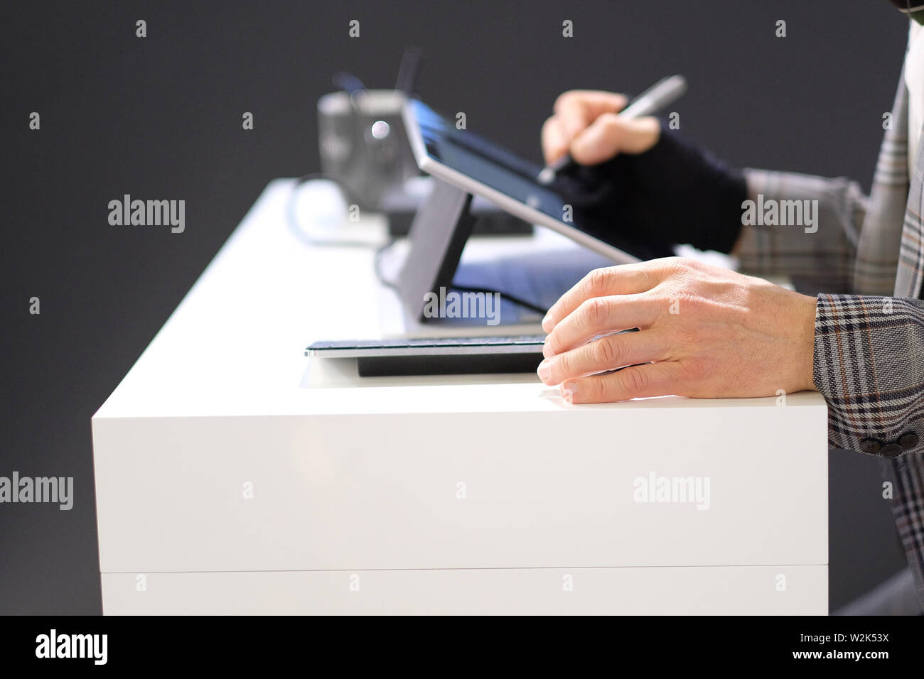 The hands of a man engaged in work with information. - Stock Image