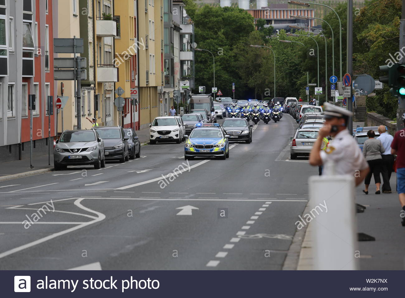 A convoy of police cars and motor cycles escort President Michael D Higgins to Würzburg on a state visit. Stock Photo
