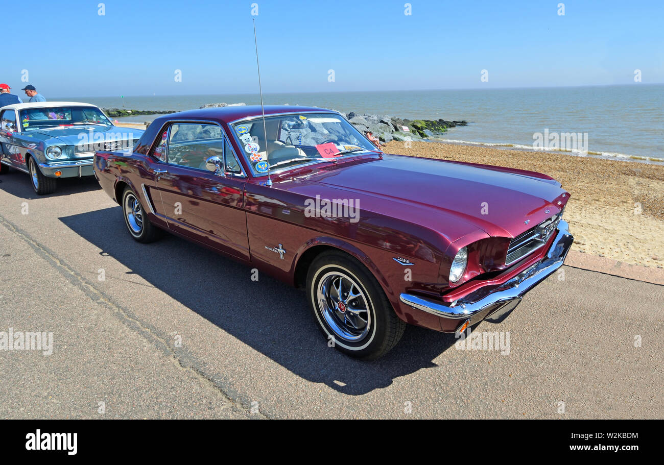 Classic Purple Ford Mustang parked on seafront. Stock Photo