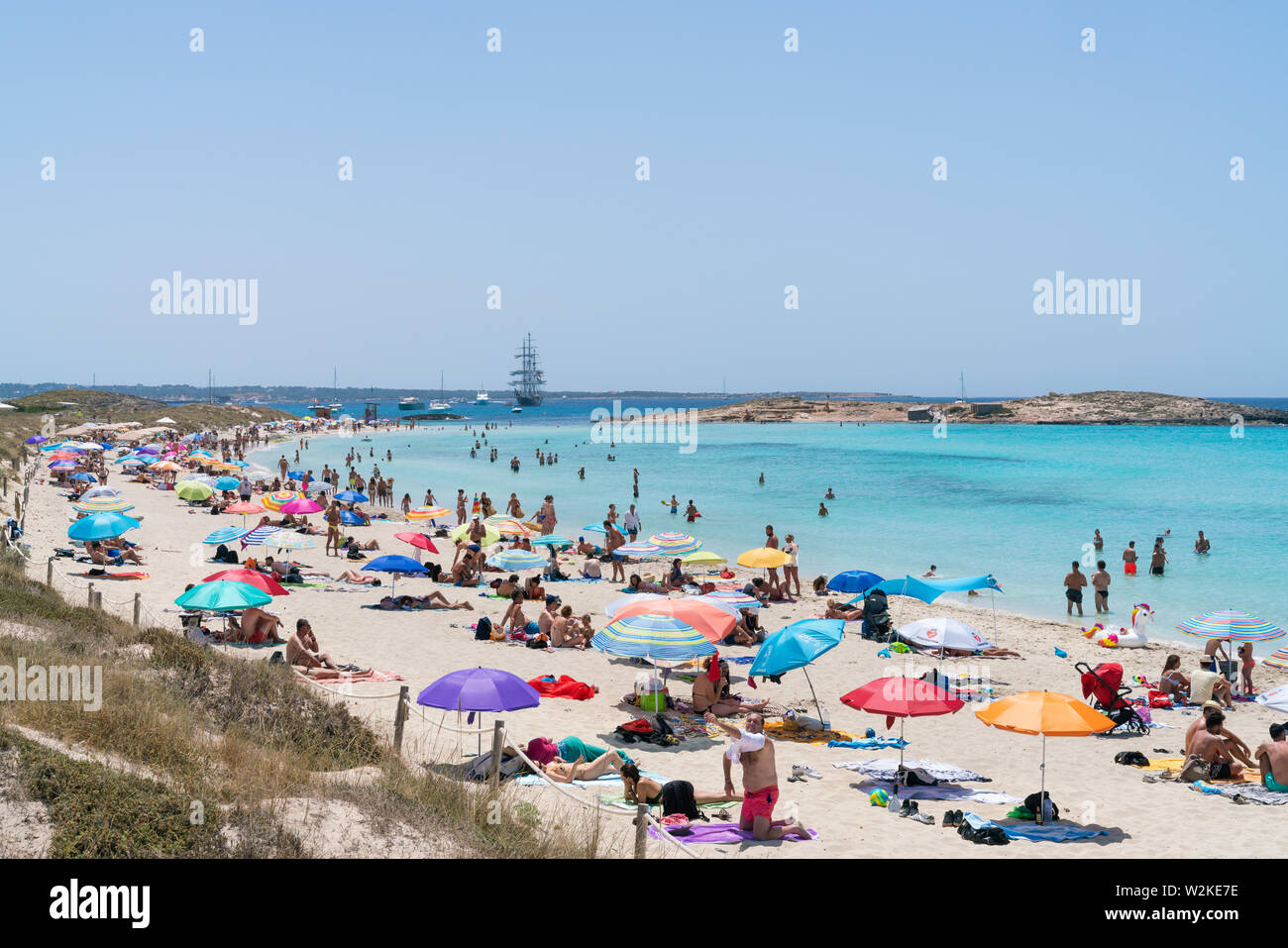 22th June 2019 - Formentera, Spain. People sunbathing on the Playa de Ses Illetes, Balearic Island of Formentera. - Stock Image