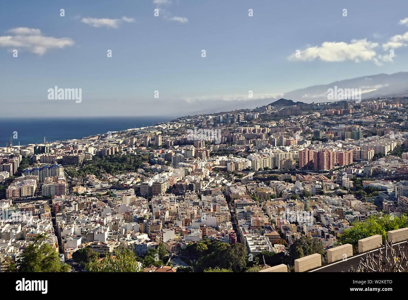 View of the capital Santa Cruz de Tenerife from the Mirador de los Campitos in the evening sun and blue sky. Stock Photo