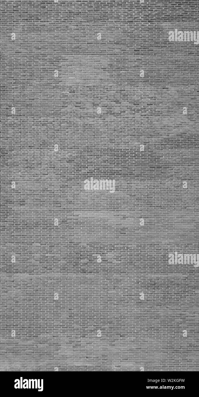 High resolution full frame textured background of a big, new and clean brick wall in black and white. Stock Photo