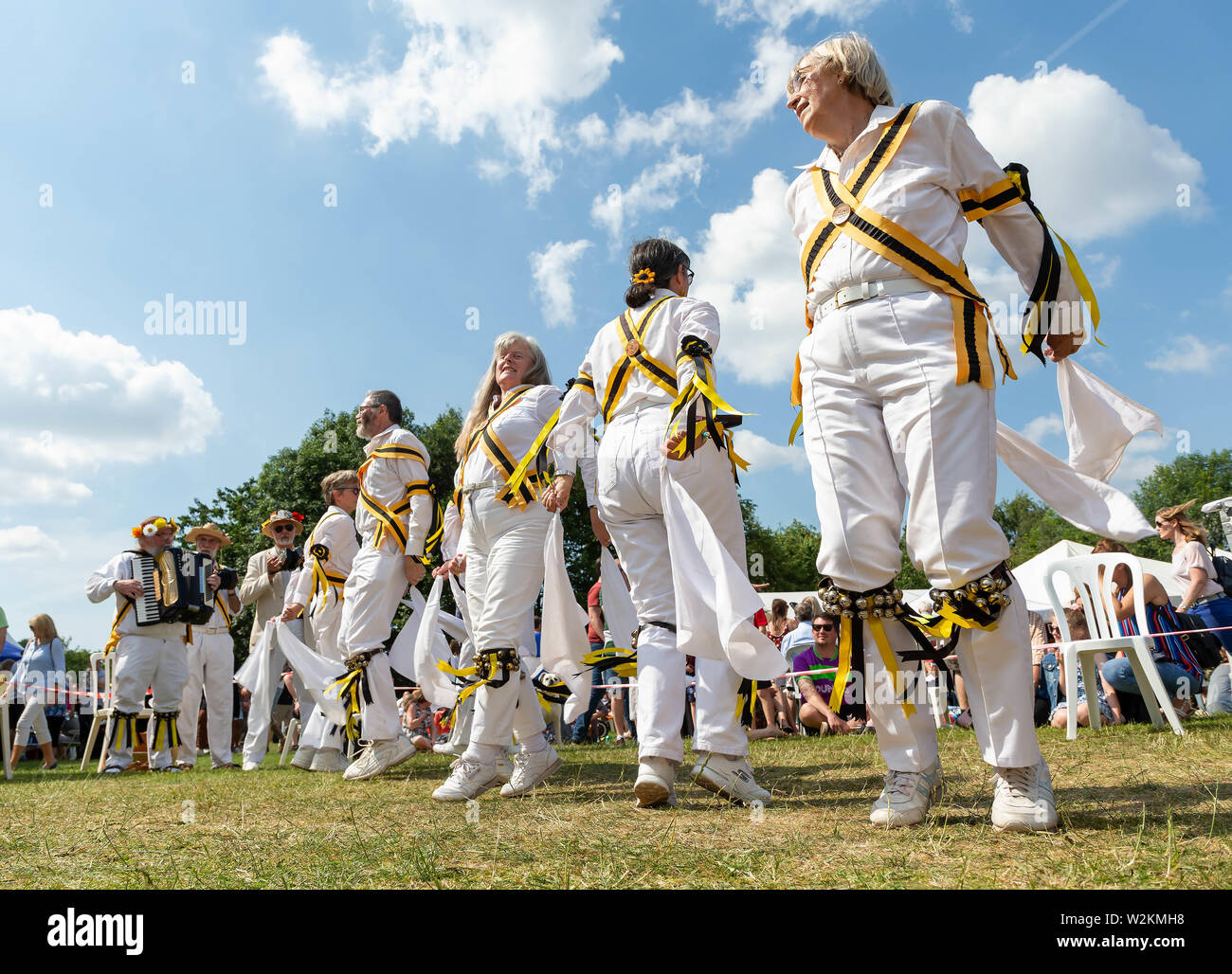 The Earl of Stamford Morris perform a dance at the 2019 Stockton Heath Festival under a hot sun Stock Photo
