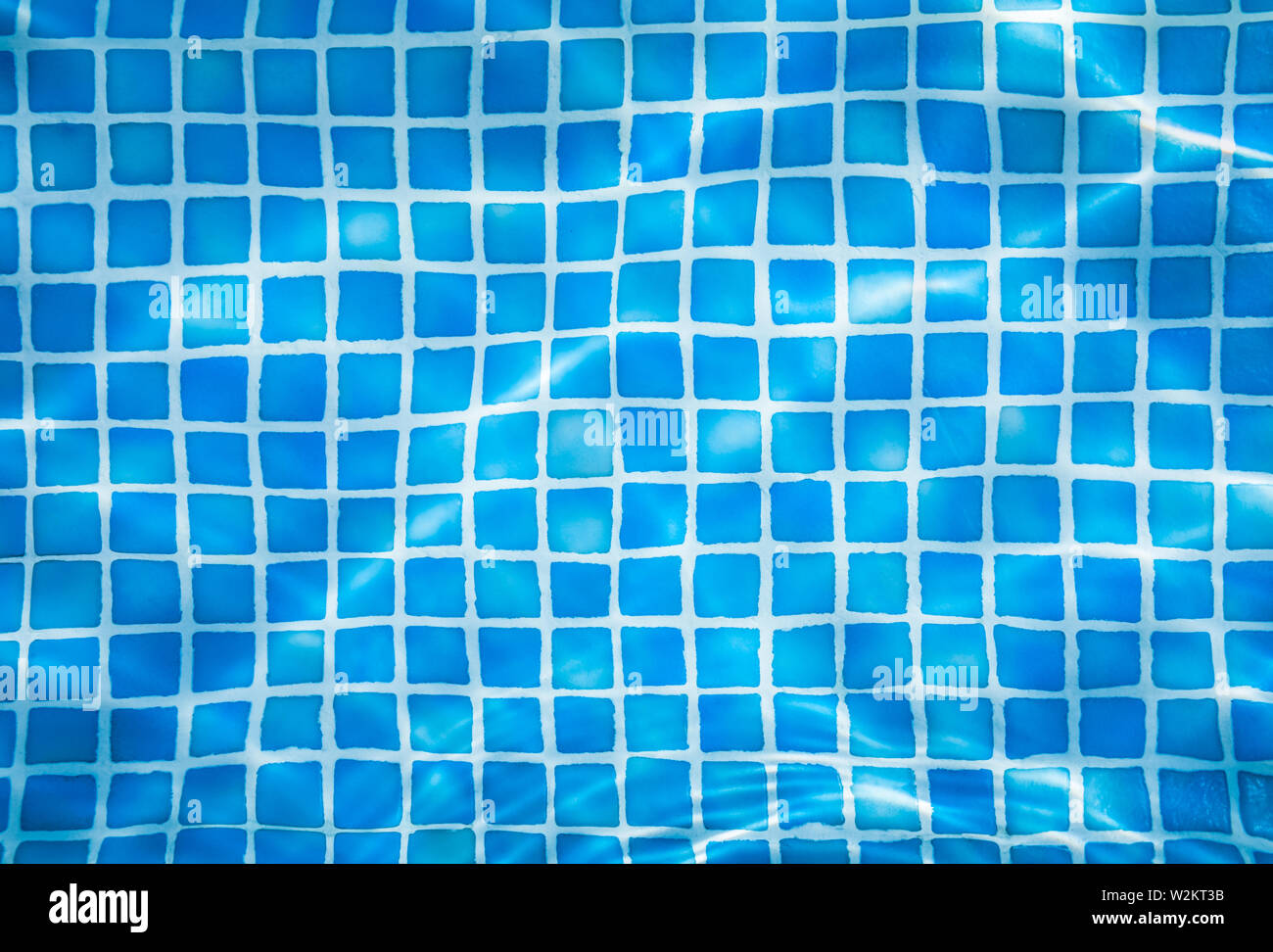 Vacation Abstract Background Of Water Ripples Over Swimming Pool Tiles Stock Photo