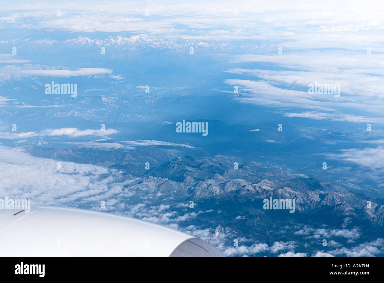 Endless cloudy sky, view from the airplane. Airline theme, travel and business trip by plane Stock Photo