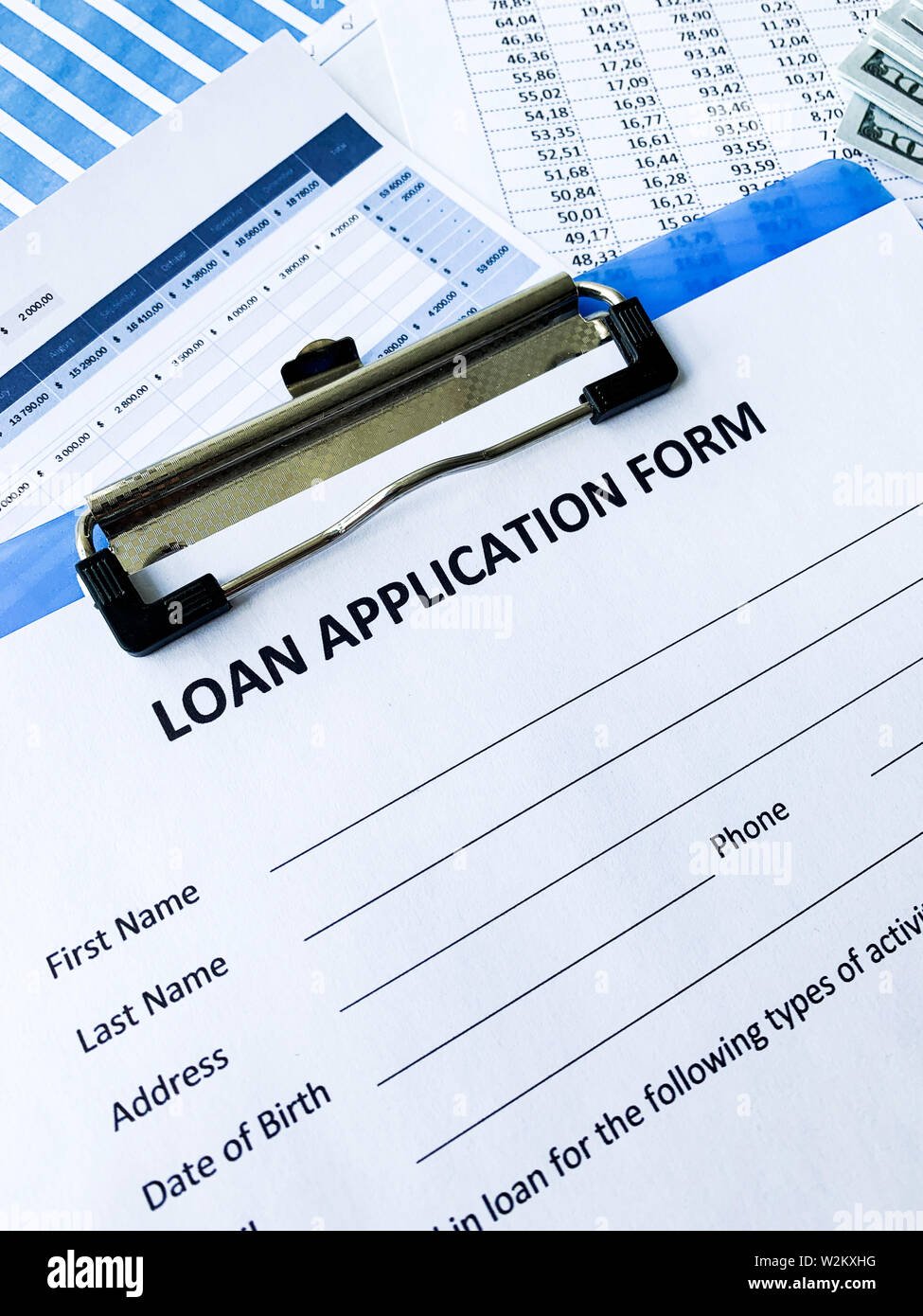 Loan application form document with graph on table - Stock Image