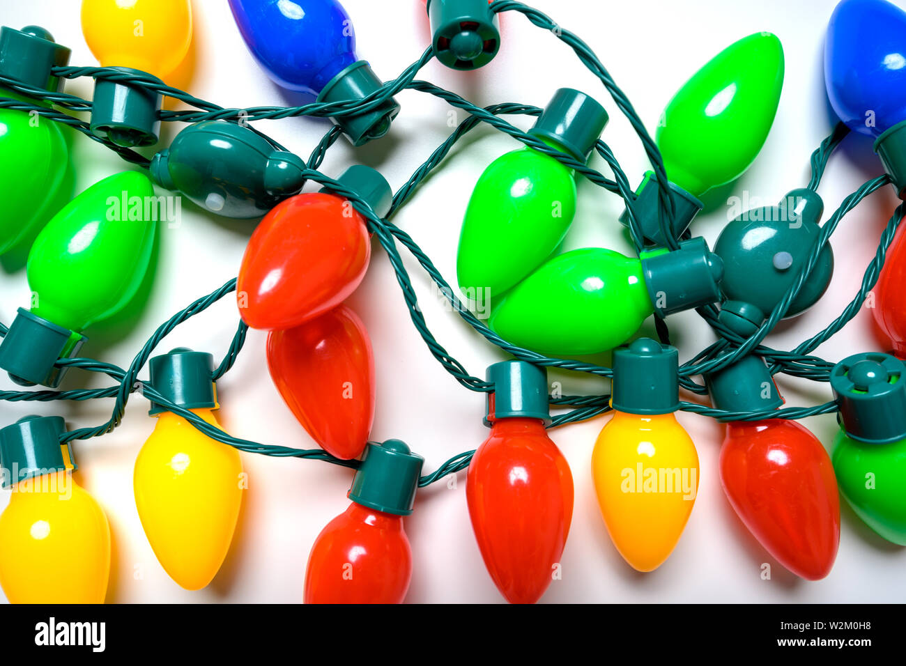Colorful Christmas lights on a white background Stock Photo