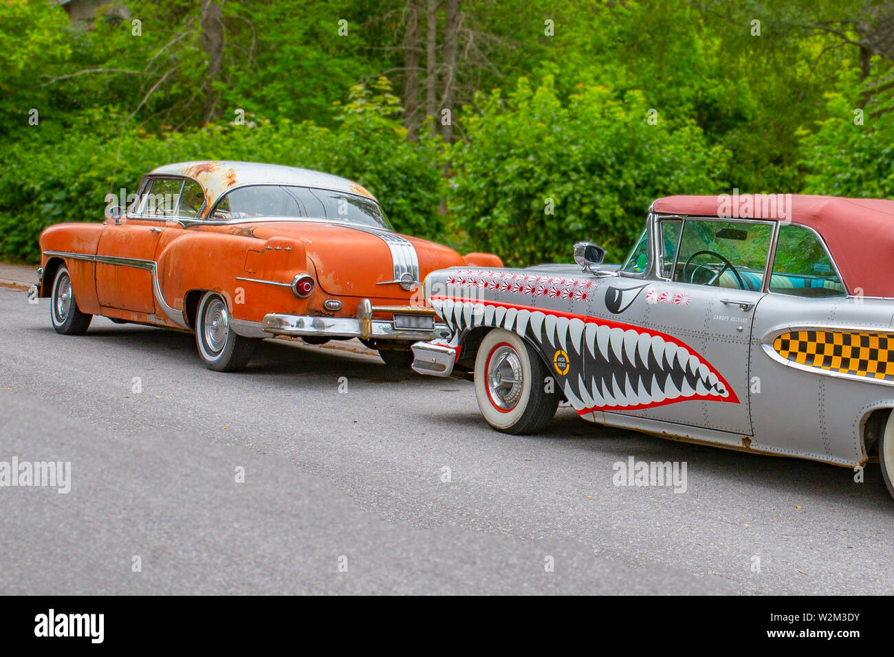 Turku, Finland - 02 July, 2018: Circa 1954 Pontiac Chieftan and circa 1958 Edsel Pacer convertible painted like a WWII era fighter plane. - Stock Image