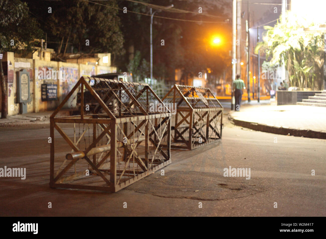 While the army have been removed from the main roads, barricades are still present at several key locations in Dhanmondi. A mutiny by Bangladesh Rifles, BDR, soldiers broke out in their Headquarter in Pilkhana, in the morning of 25th February, making the area into almost a war zone. Several thousand shots were fired from machineguns, killing more than a hundred army officers, at the BDR Pilkhana Headquarters and several civilians near the area. Dhaka, Bangladesh. February 25, 2009. - Stock Image