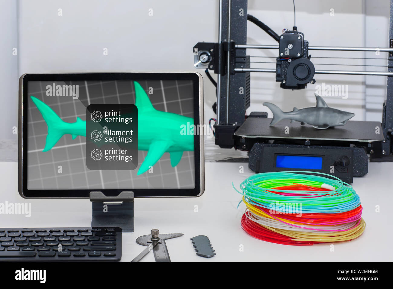 a wireless 3d printer setup using a tablet monitor, keyboard and 3d printing  filament and machine