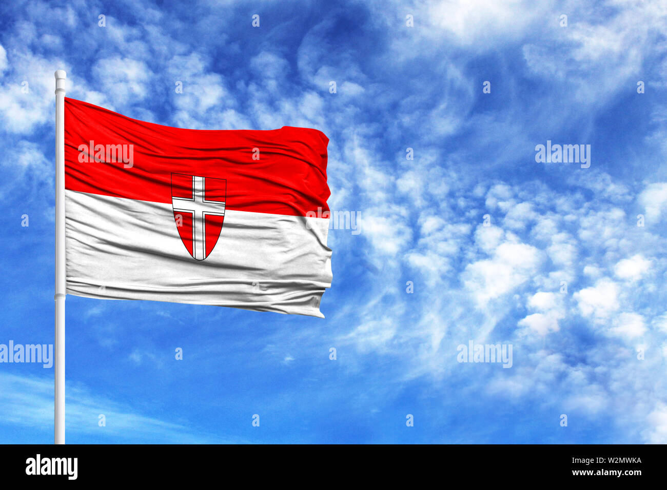 National flag of Vienna on a flagpole in front of blue sky - Stock Image