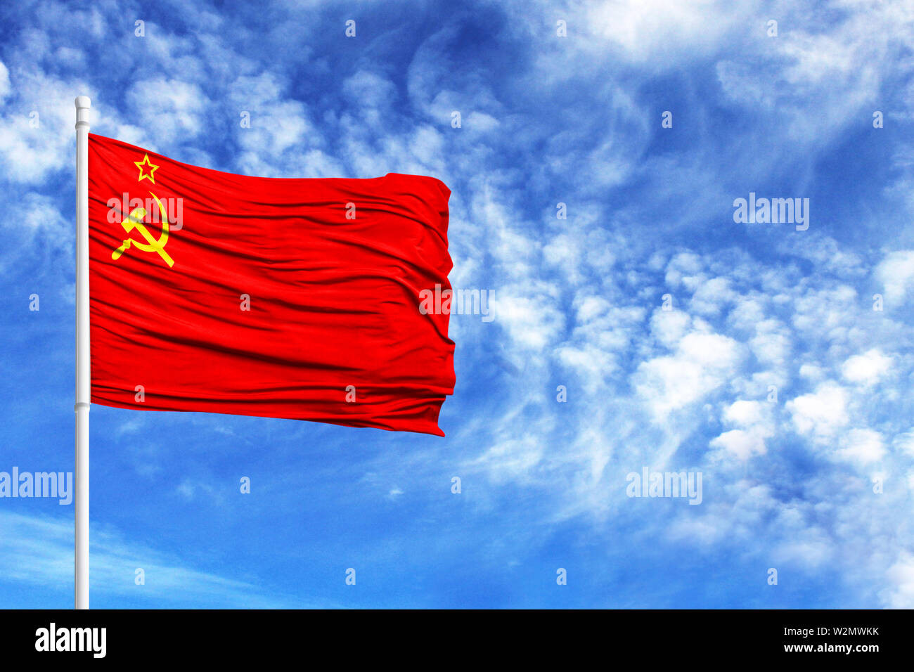 National flag of USSR on a flagpole in front of blue sky - Stock Image