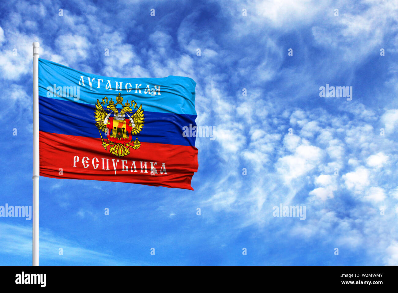 National flag of the Lugansk People's Republic on a flagpole in front of blue sky - Stock Image