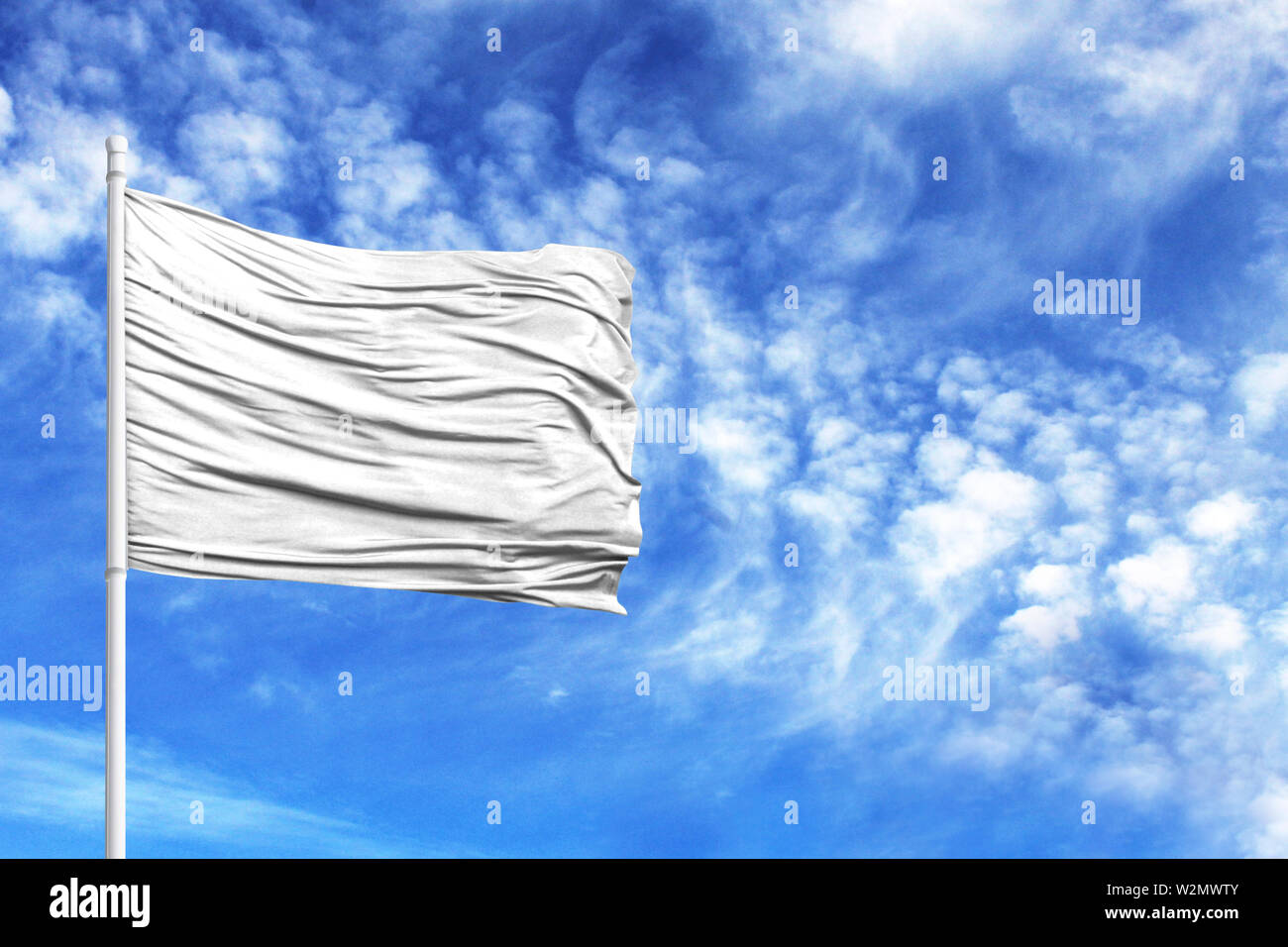 National flag of White on a flagpole in front of blue sky - Stock Image