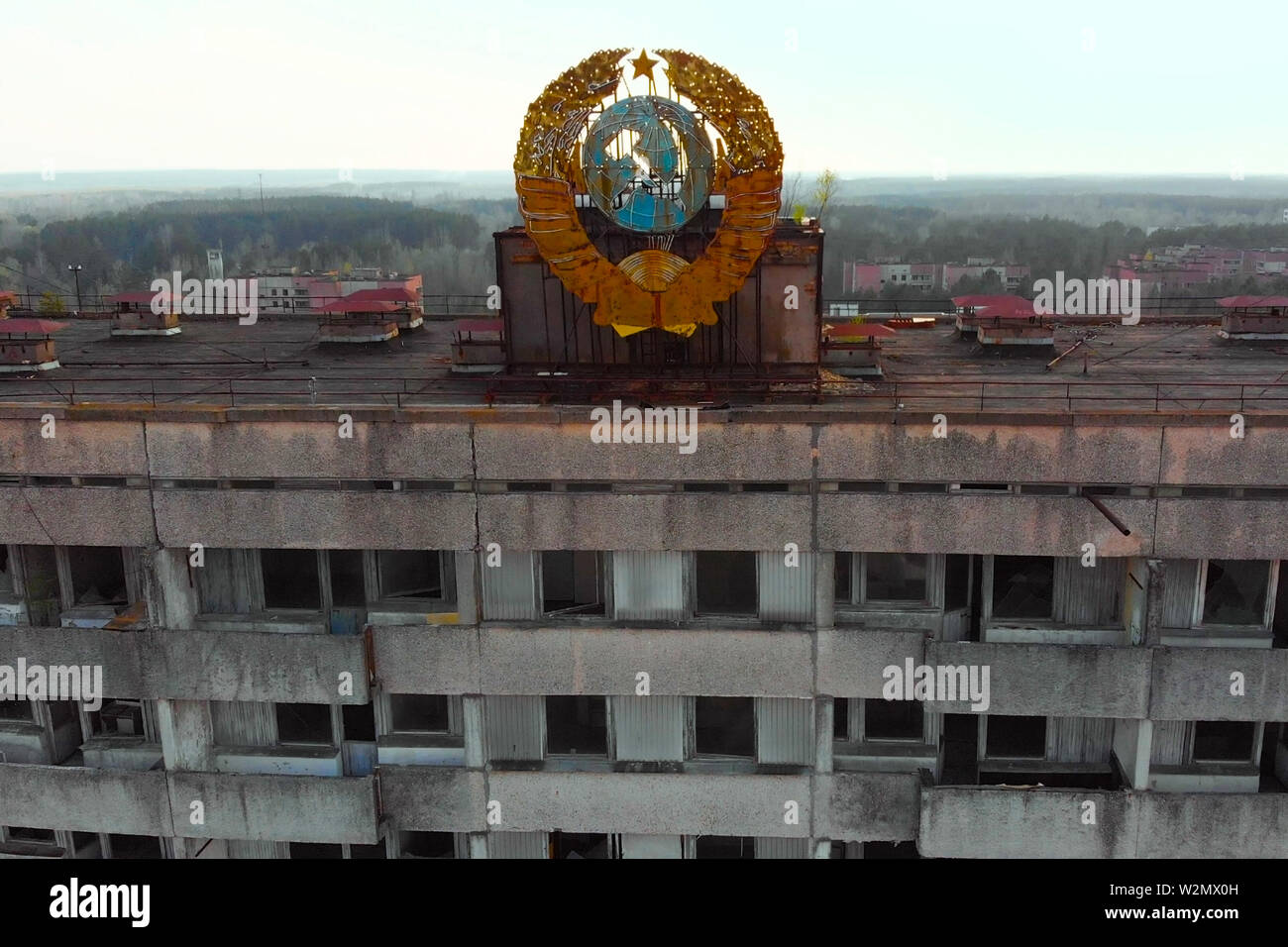 Soviet coat of arms on a building in Pripyat - Stock Image