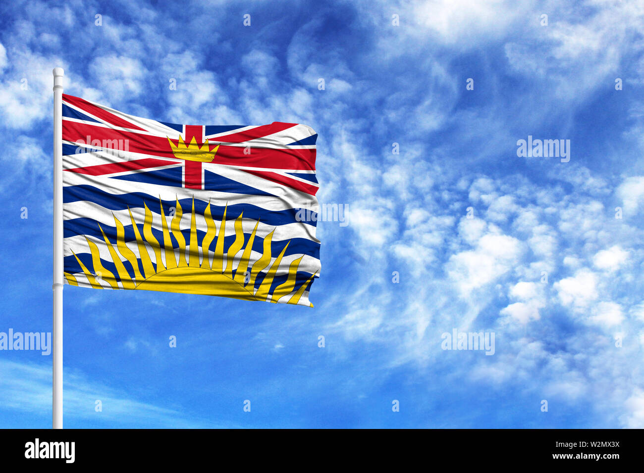 National flag of British Columbia on a flagpole in front of blue sky - Stock Image