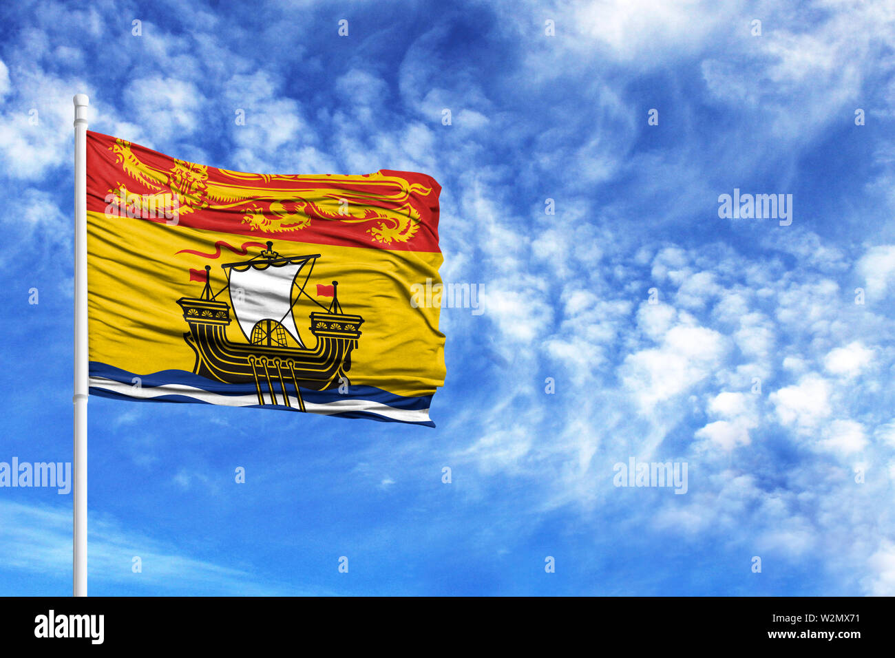 National flag of New Brunswick on a flagpole in front of blue sky - Stock Image