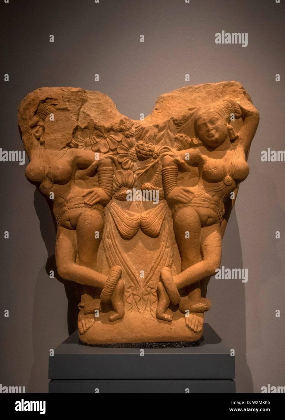 Singapore, Gateway bracket with four 'shalabhanjikas' ( Northwest India-2nd century. Kushan period) a sandstone at the Asian Civilisations Museum. - Stock Image