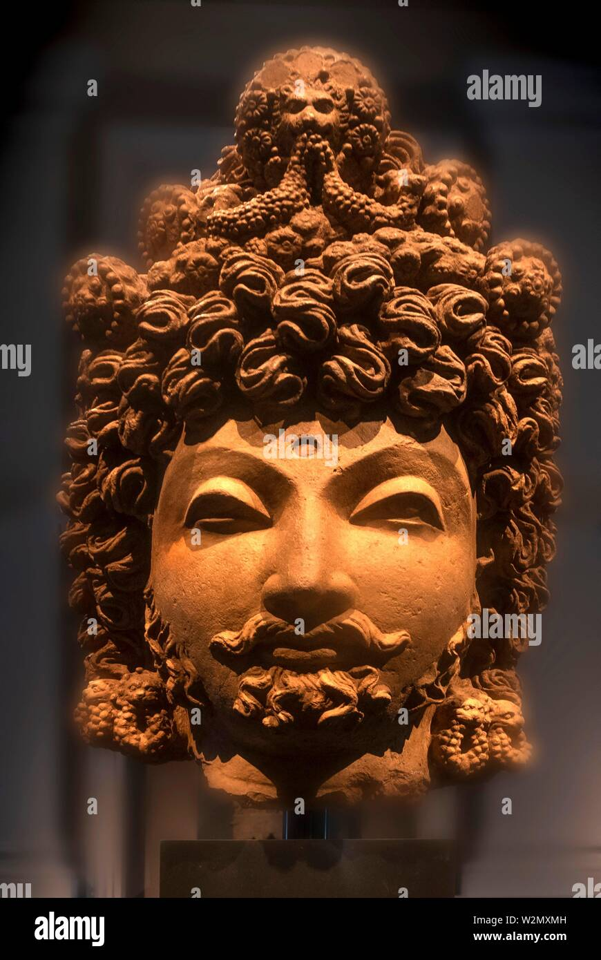 Singapore, Head of a Bodhisattva. ( Gandhara-4th century) Terracotta, at the Asian Civilisations Museum. - Stock Image