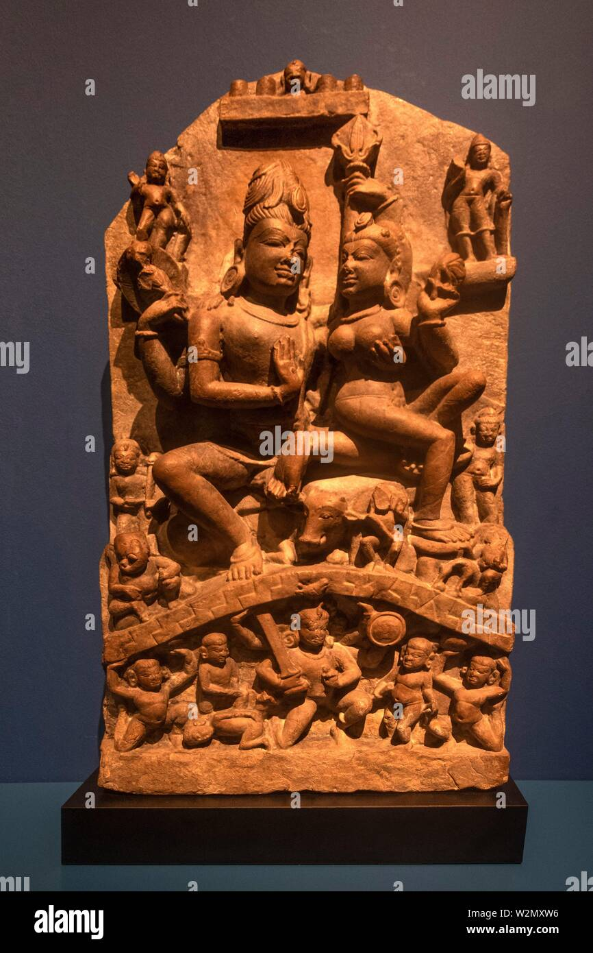 Singapore, Asian Civilisations Museum. Family of Shiva (Northern India, 9th. century), sandstone. - Stock Image
