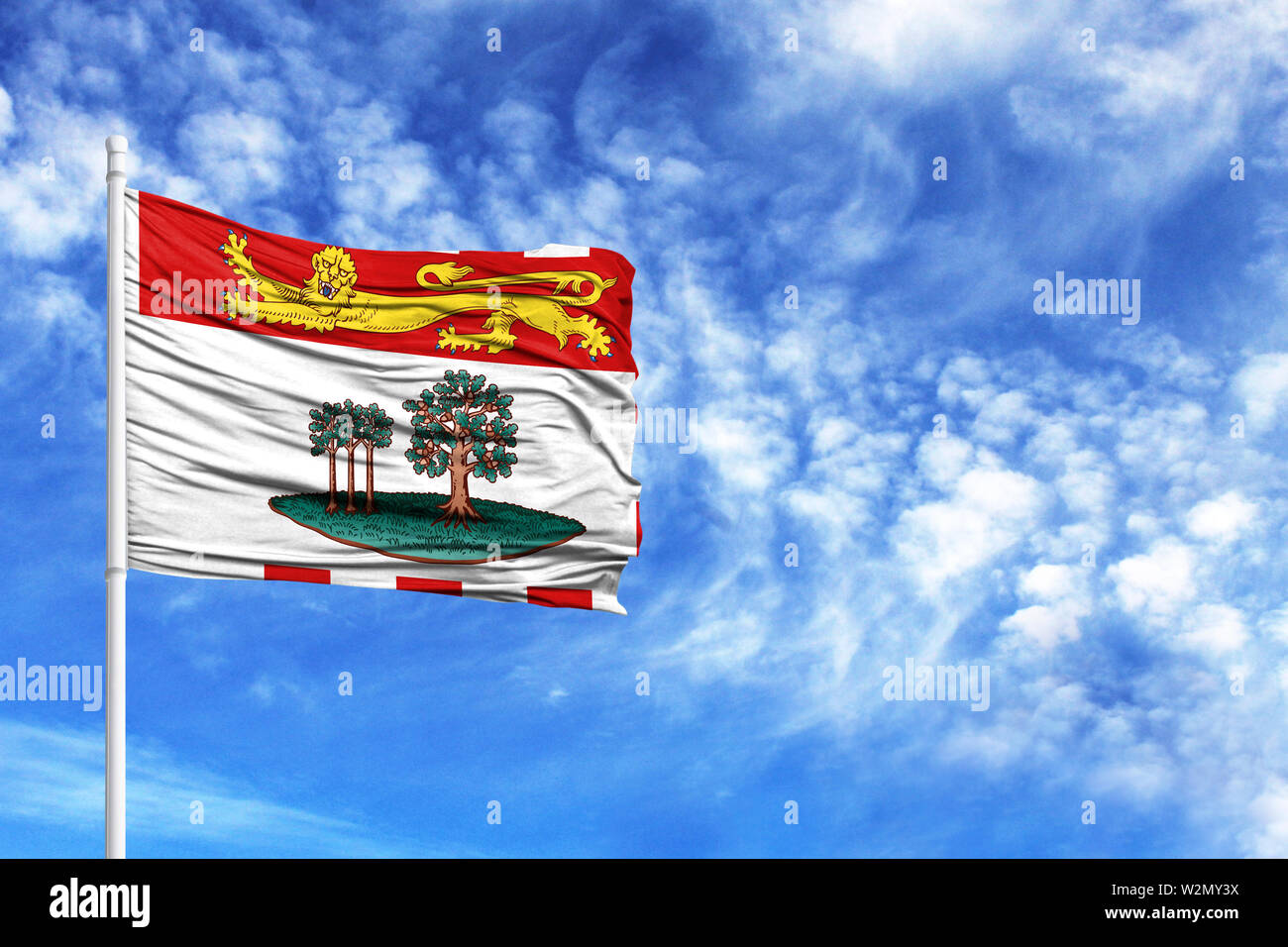 National flag of Prince Edward Island on a flagpole in front of blue sky - Stock Image