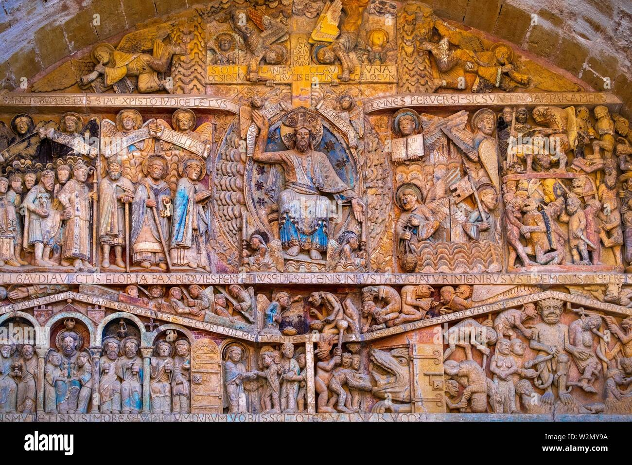 France, Occitanie, Lot,  detail of the tympanum of the Abbey Church of Conques. Pilgrimage way to Santiago dee Compostela. - Stock Image