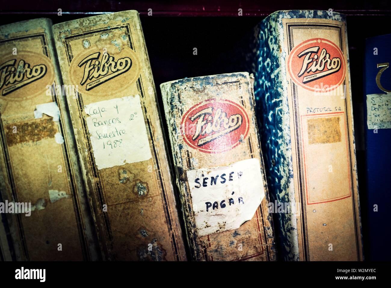 Close up of invoice folders on a shelf. Mahon, Balearic Islands, Spain, Europe. - Stock Image