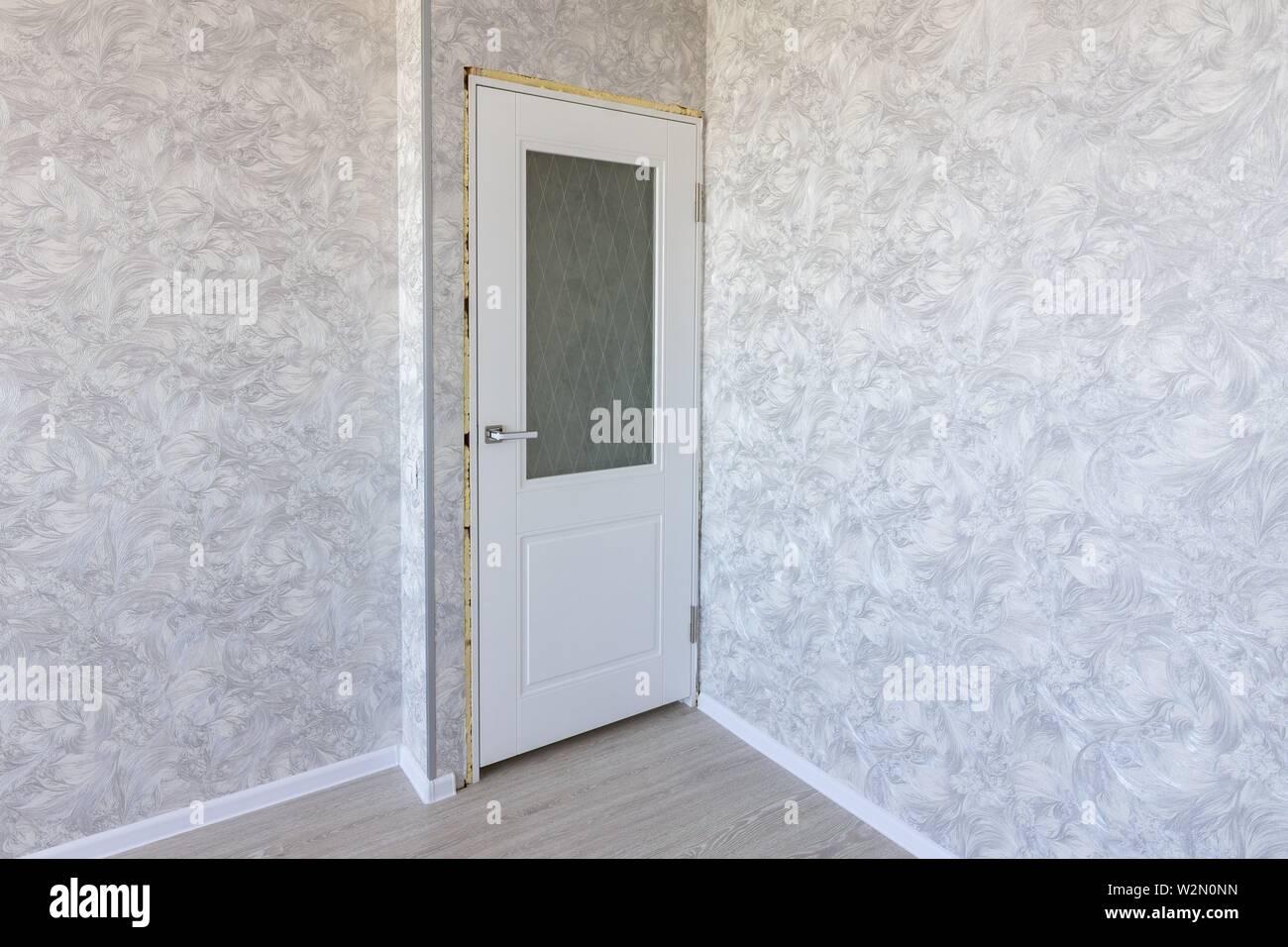 Installed interior door after repair. - Stock Image