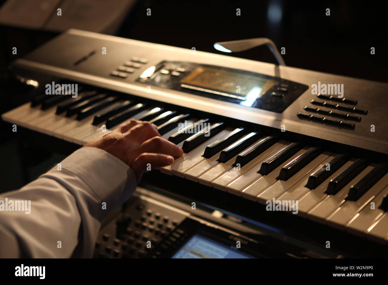 electric keyboard close u with players hand - Stock Image