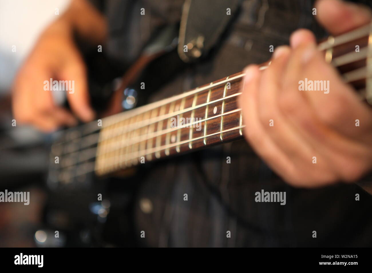Musician, guitar player performs. - Stock Image