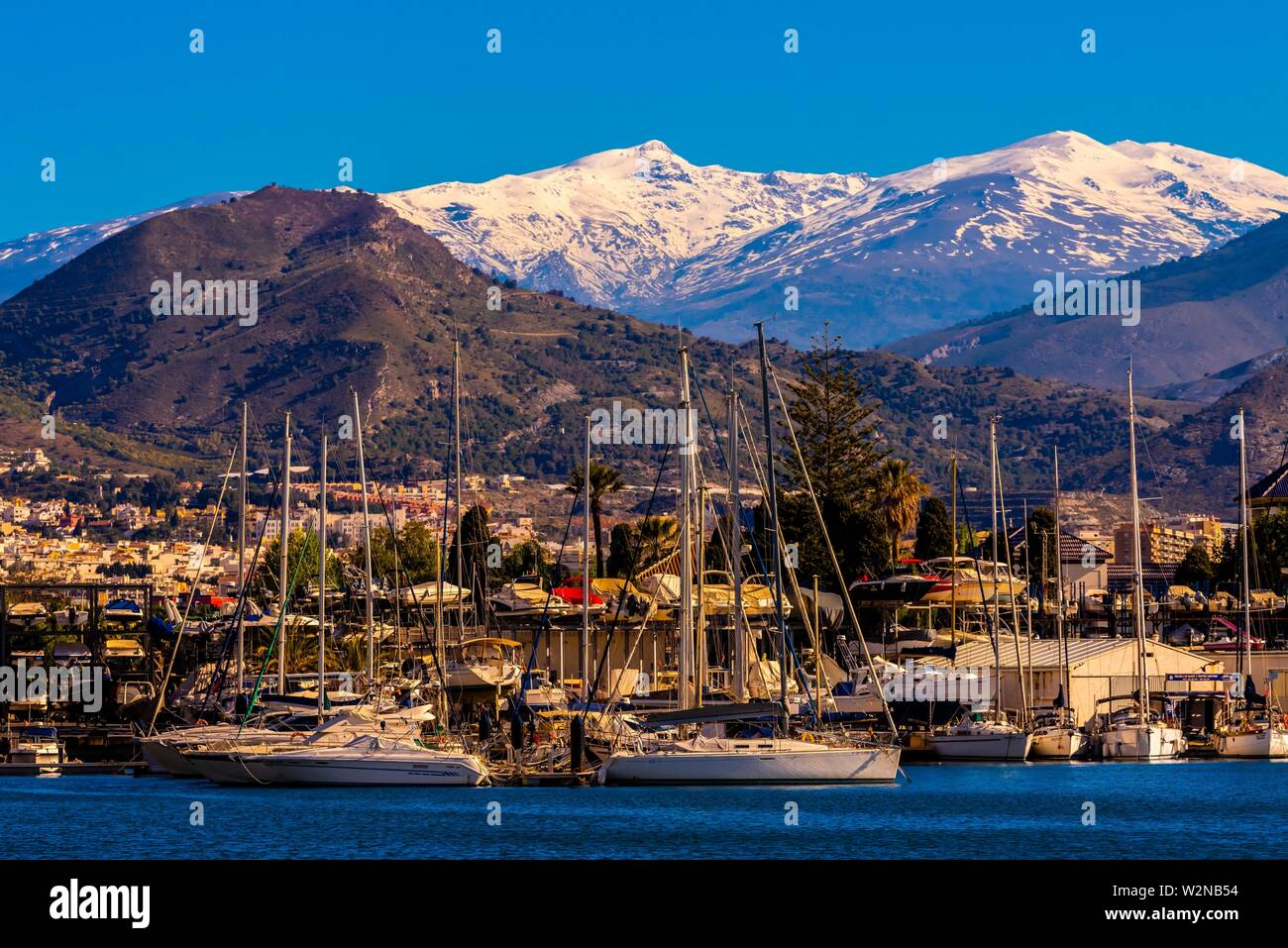 Sailboats In The Harbor Of Motril On The Costa Tropical Of Granada Province With The Snow Capped Sierra Nevada Mountains In The Background Stock Photo Alamy