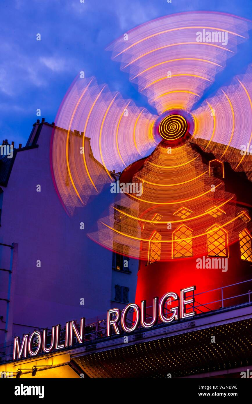 Moulin Rouge (French for Red Windmill) is a tourist attraction in Pigalle on Boulevard de Clichy, 18th arrondissement. It is best known as the Stock Photo
