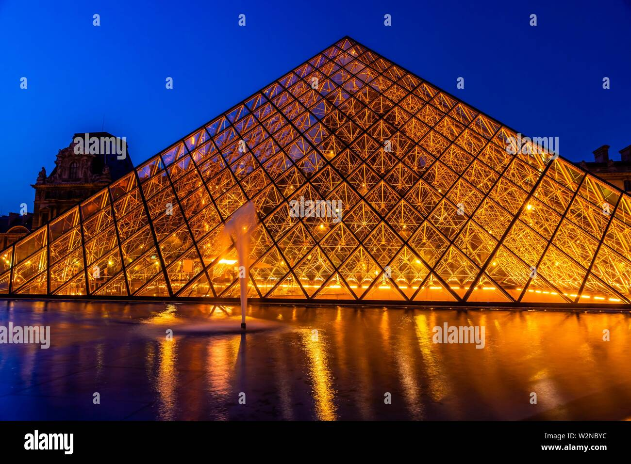 The Louvre Pyramid (Pyramide du Louvre) is a large glass and metal pyramid designed by Chinese-American architect I. M. Pei, surrounded by three Stock Photo