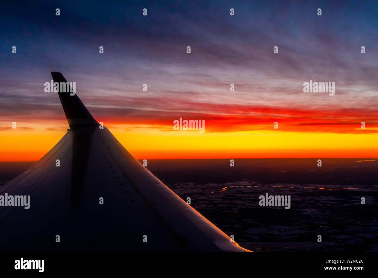 A Norwegian Air Shuttle Boeing 787 Dreamliner after take off predawn from Oslo Gardermoen Airport, Norway. - Stock Image