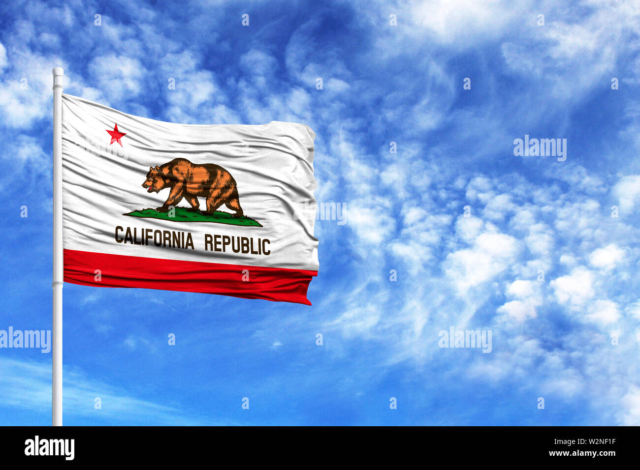 National flag State of California on a flagpole in front of blue sky - Stock Image