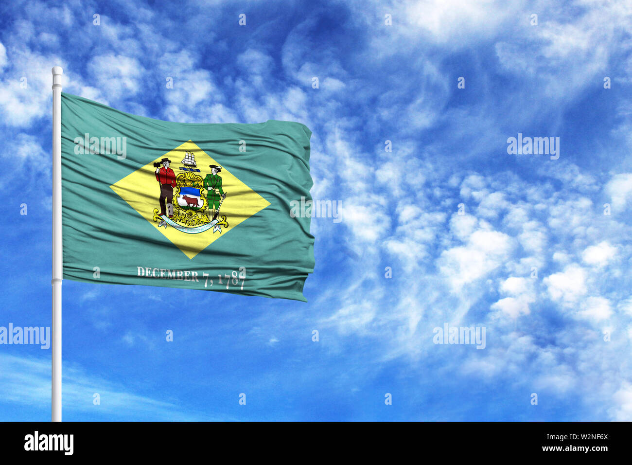 National flag State of Delaware on a flagpole in front of blue sky - Stock Image