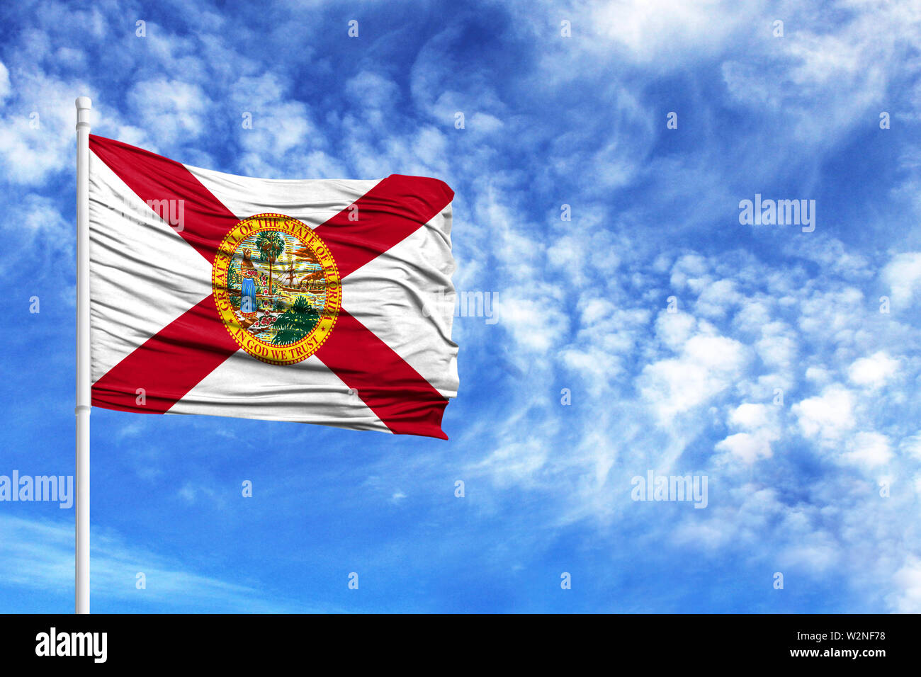 National flag State of Florida on a flagpole in front of blue sky - Stock Image