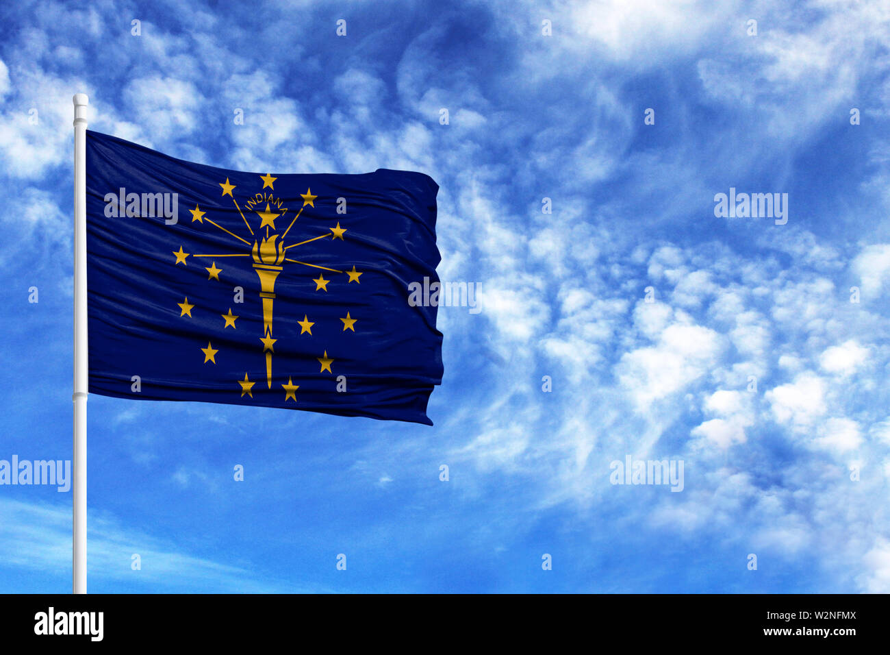National flag State of Indiana on a flagpole in front of blue sky - Stock Image