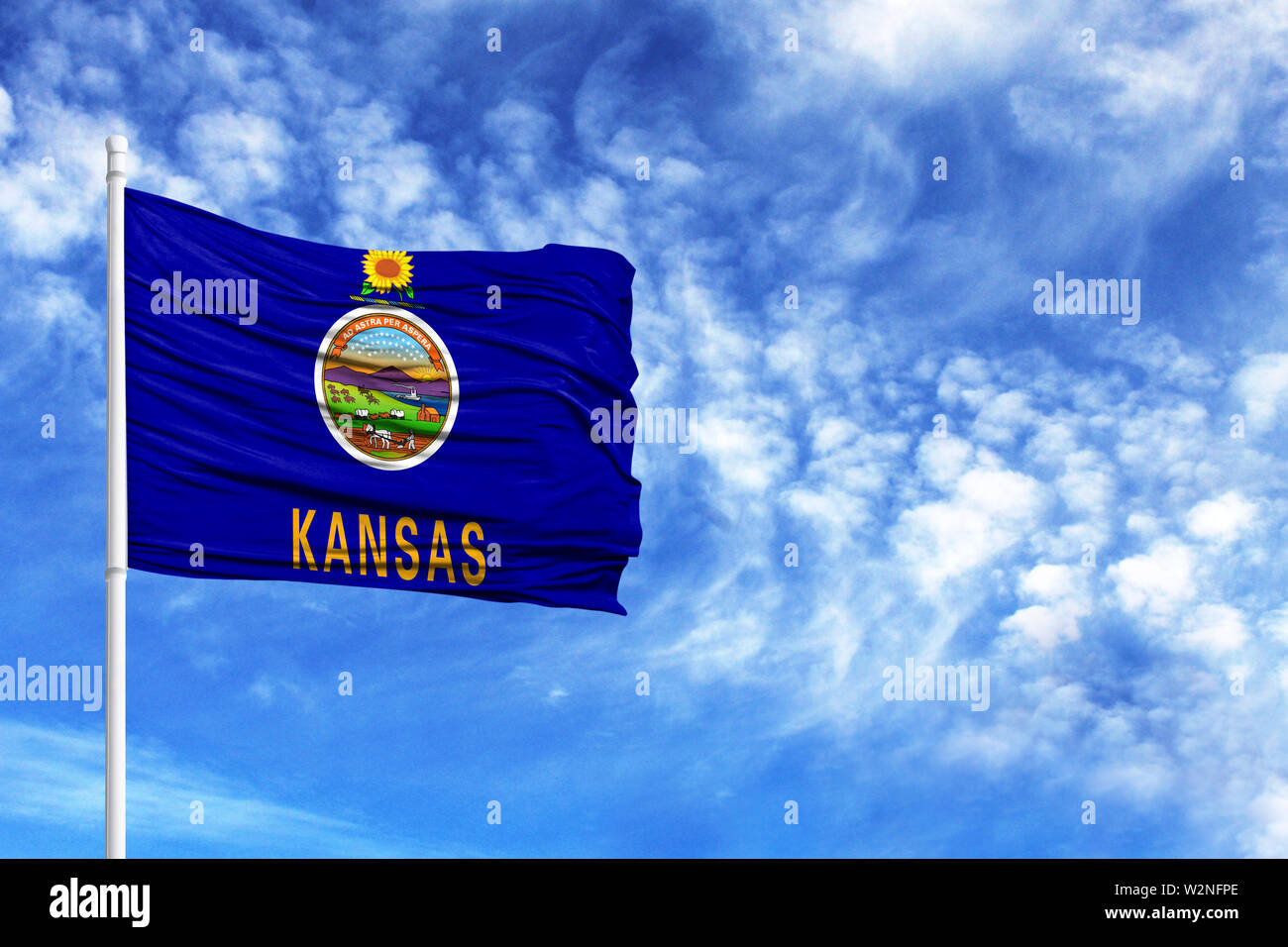 National flag State of Kansas on a flagpole in front of blue sky - Stock Image