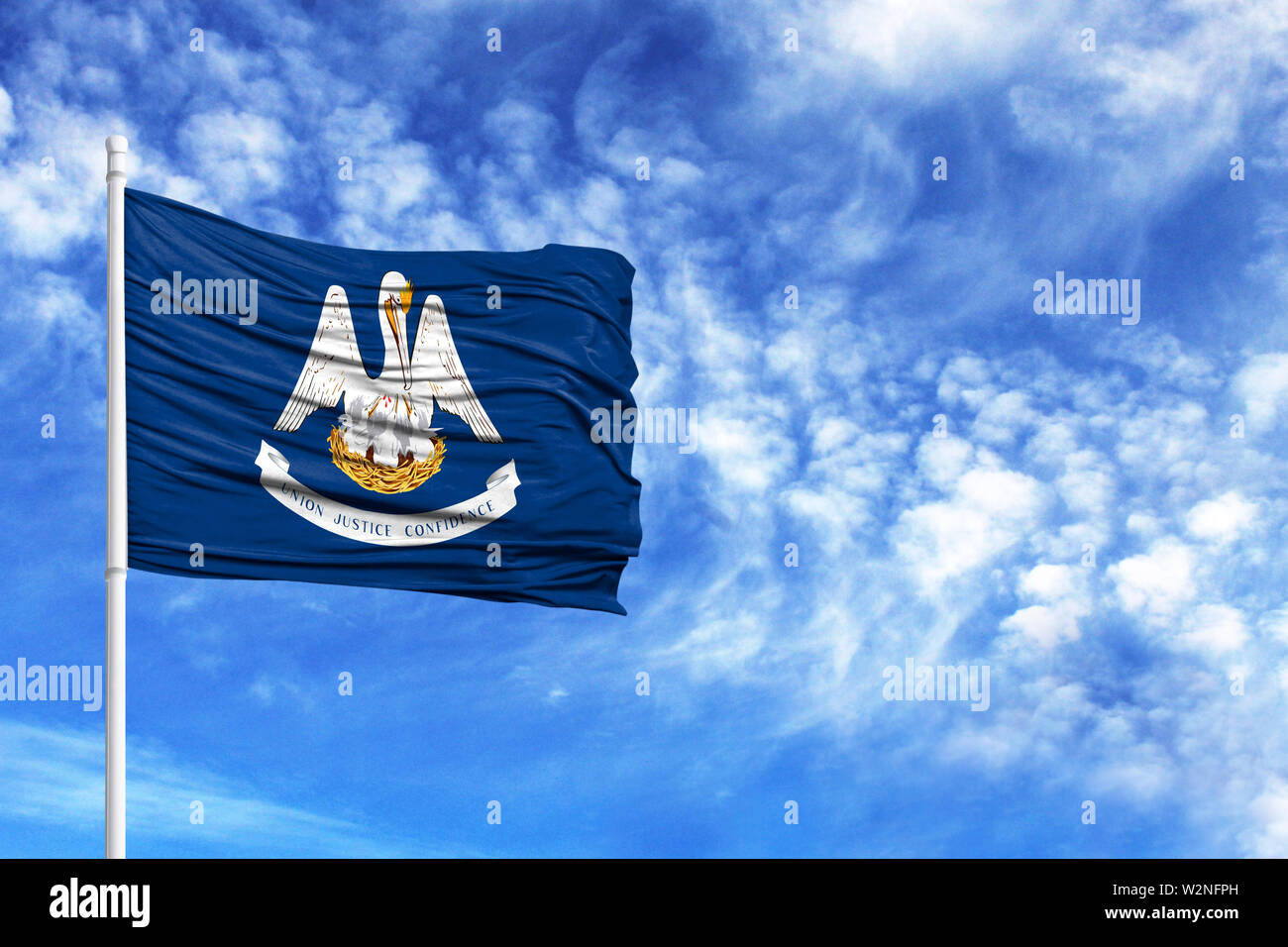 National flag State of Louisiana on a flagpole in front of blue sky - Stock Image