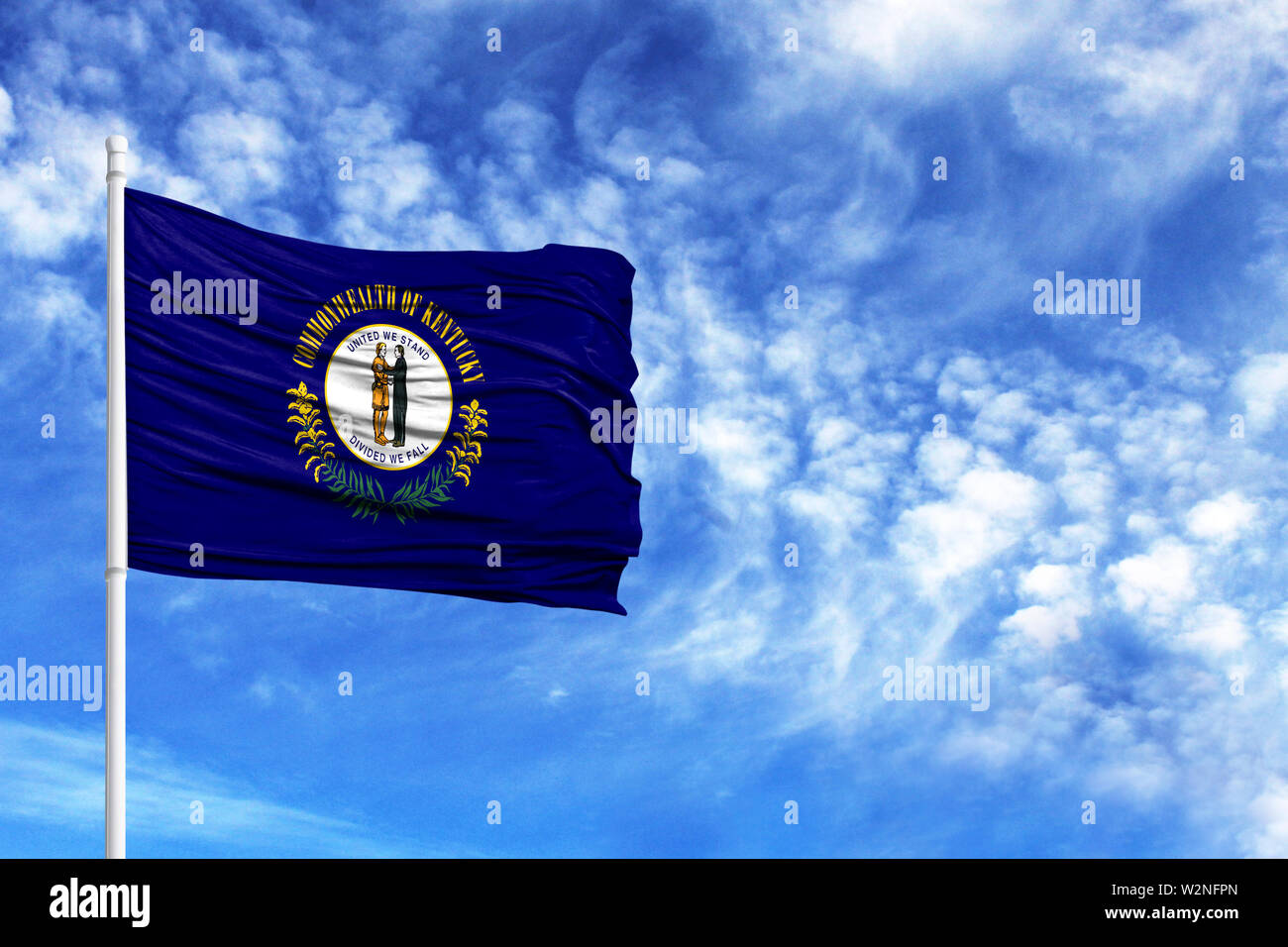National flag State of Kentucky on a flagpole in front of blue sky - Stock Image